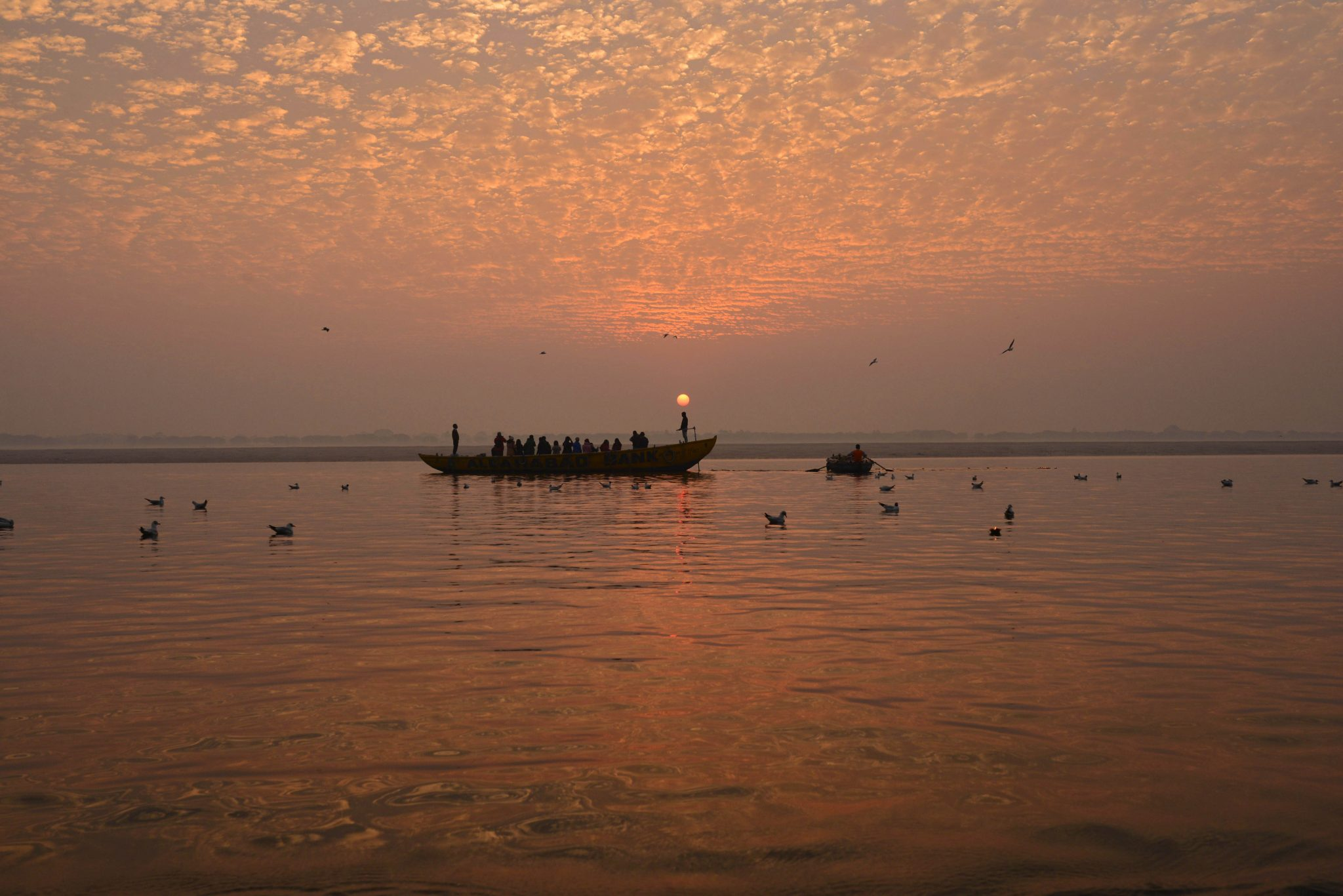 A blood red sun rising over the Ganges