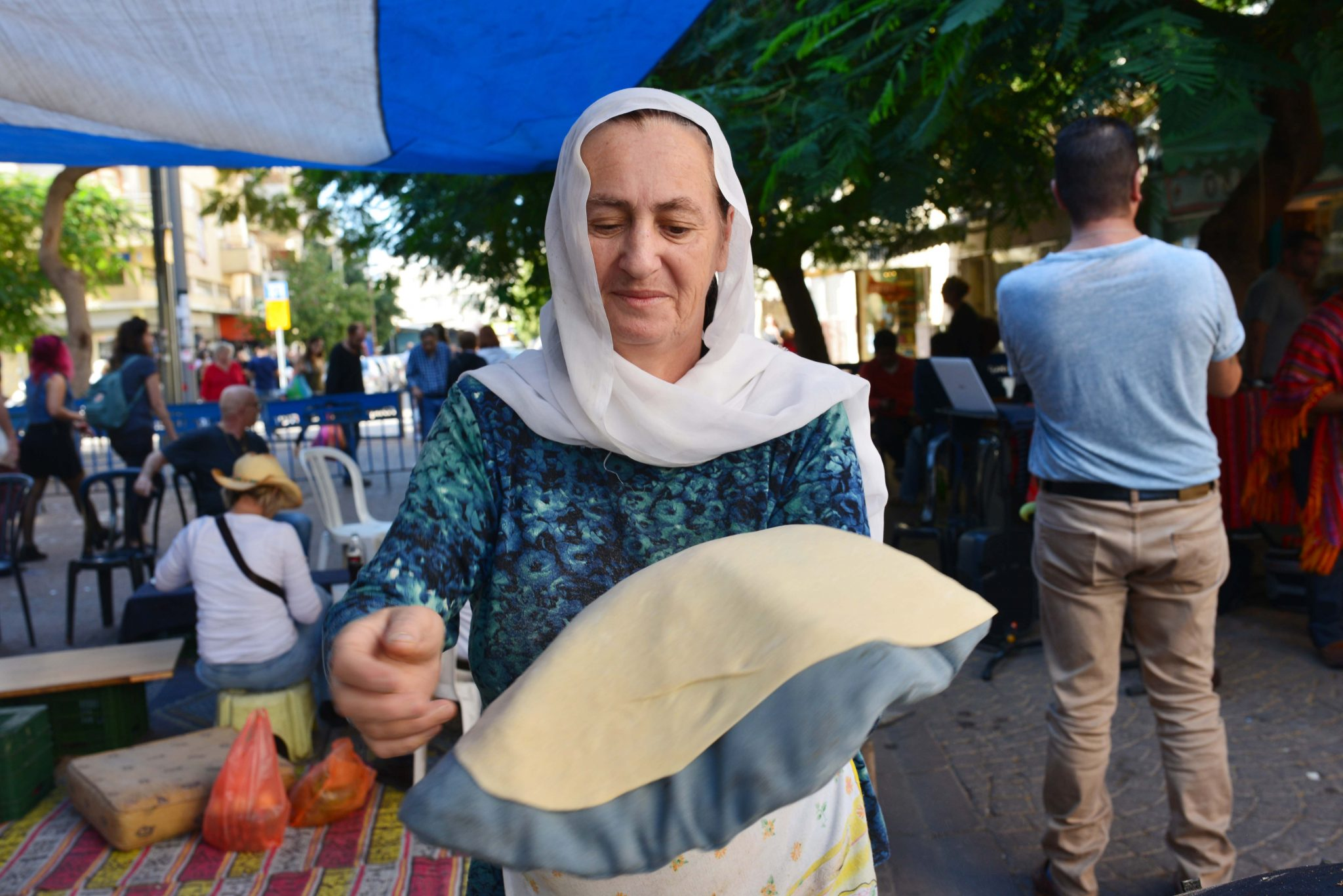 Israeli Druze woman preparing saj in Carmel Market